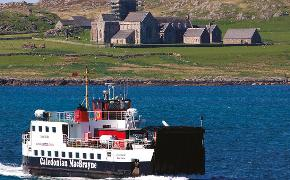 Iona abbey with ferry MV Loch Buie