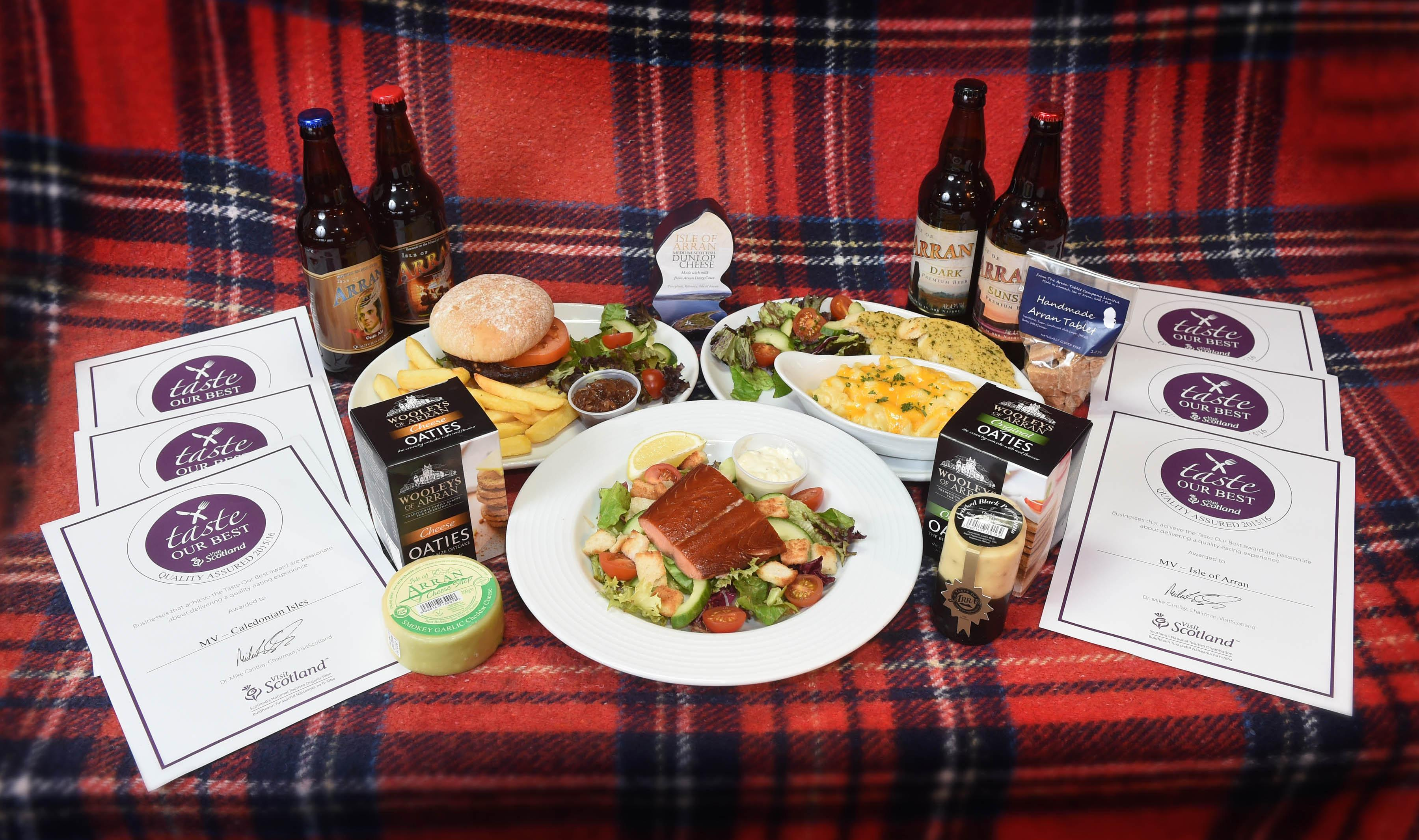 Taste our best awards displayed on a table with plates of freshly made meals served onboard CalMac ferries.