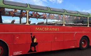 A red MacBraynes Bus