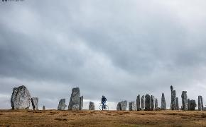 Mark Beaumont on a bike at Callanish Stones, Lewis
