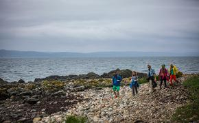 Climbers on the shore, Arran