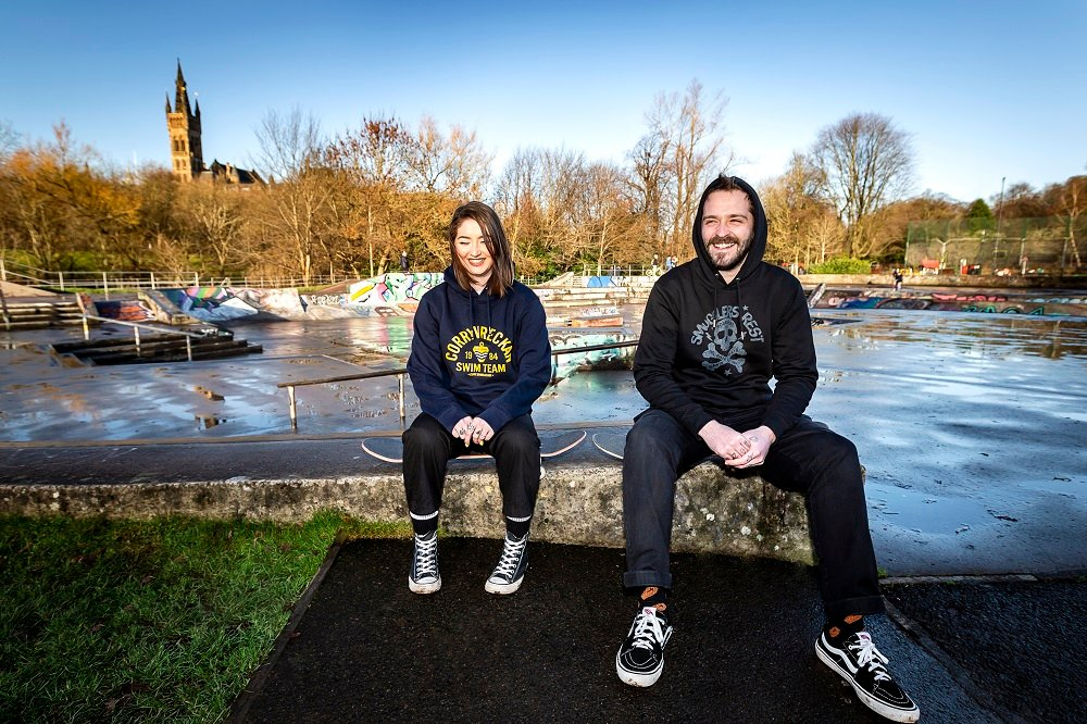 Girl and guy wearing Corryvwrecken and Smuggler's Rest Hoodies in skatepark